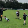 Conor Laverty coachings kids how to block down a gaelic football